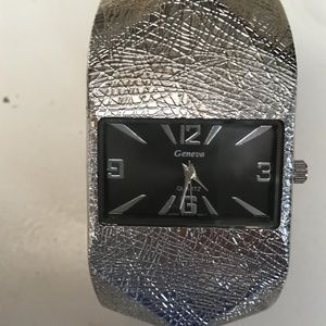geneva large silver scuptural watch